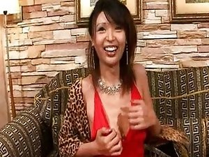Ladyboy strippping out of his evening dress