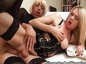 Shemale in fishnets is fucked by a shemale